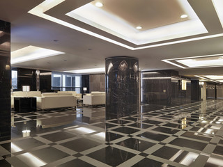 Grand foyer with patterned tile in apartment building lobby