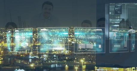 Digital composite image of business people seen through screen