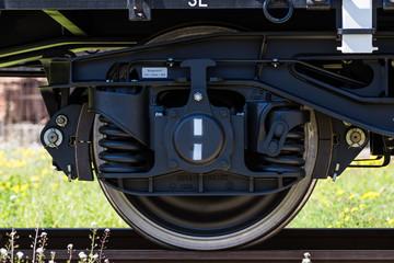 Burgas, Bulgaria - March 20, 2017 - Freight cargo train Wheel - 4axled flat wagon white Type:Rens Model:192, B - Transvagon AD