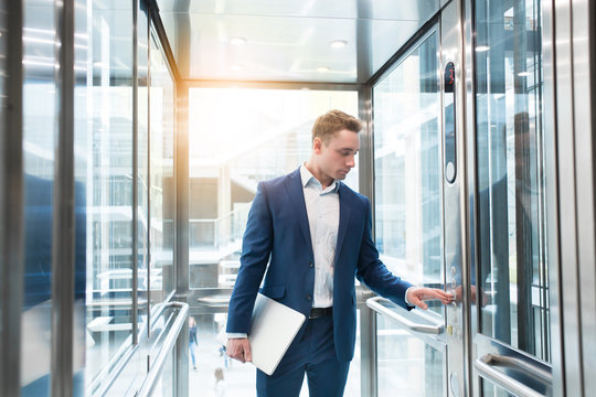 Businessman in elevator in the office center