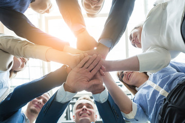 business people teamwork stacking hand together