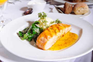 Grilled Salmon Steak with Spinach,Mash potato, souse