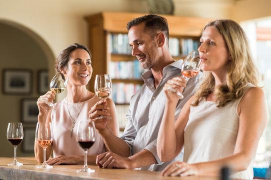 Friends tasting wine