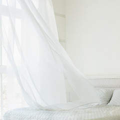 Abstract white waving curtain in white bedroom