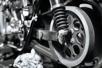 Picture of dissembled bike in mechanics workshop