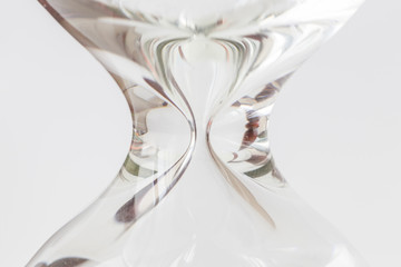 Close up body shape of hourglass or sandglass on white background.
