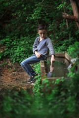 boy sitting on the source of the stream
