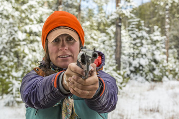 Caucasian woman aiming handgun in winter