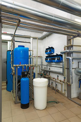 Modern water treatment system with automatic control units in industrial gas boiler house