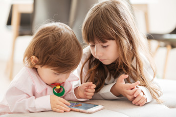 Cute children using smartphone