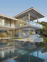 View of multiple story modern home with swimming pool