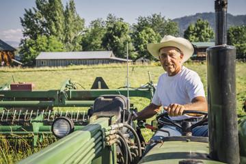 Portrait of Caucasian farmer on tractor