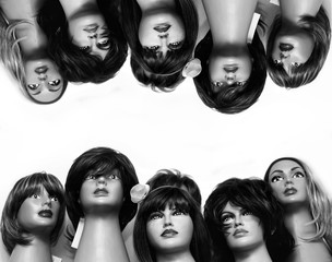 Group of female mannequin heads In the wigs. Black and white retro photo.