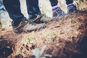 Close-up of legs of  hikers standing on the forset.
