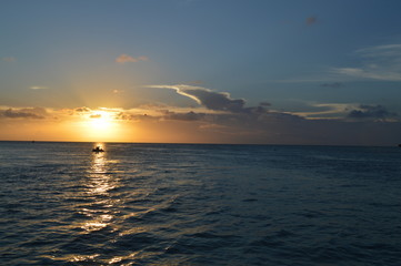 People Enjoying a Caribbean Sunset on a Little Boat, Split, Caye Caulker, Belize