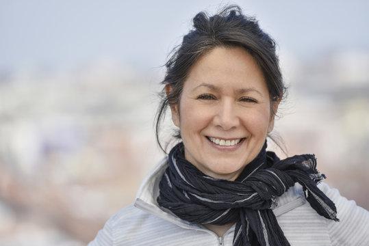 Smiling Hispanic woman wearing scarf