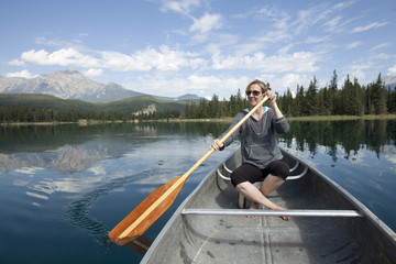 Caucasian woman paddling in kayak