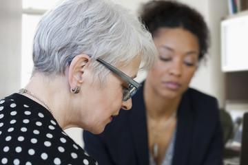 Businesswomen looking down in office