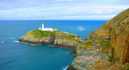 The South Stack Lighthouse - built on the summit of a small island off the north-west coast of Holy Island, Anglesey, Wales. Historically built in 1809 to warn ships of the dangerous rocks below.