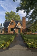 Exterior front view of red brick cottage with landscaping at Chico
