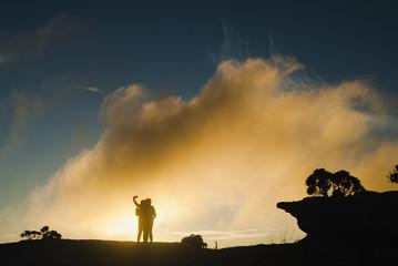 Women silhouettes at sunrise in Brazil