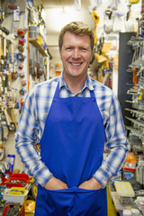 Caucasian worker smiling in hardware store