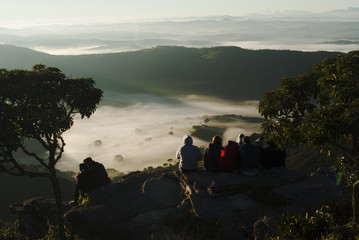 People admiring the sunrise in Brazil