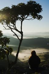 Girl admiring the sunrise in Brazil