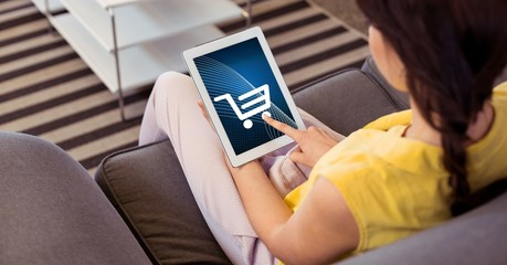 Woman touching shopping cart icon on tablet PC