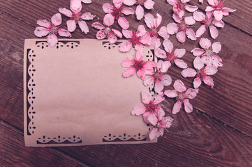 Note, postcard, writing of peach tree flowers on a wooden vintage table