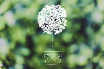 tree growing from a vase with world map on it