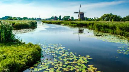 Spoed Fotobehang Molens Typical Dutch landscape in Alkmaar, the Netherlands