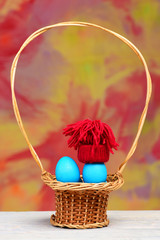 easter holiday, blue smurfs eggs in red hat in basket