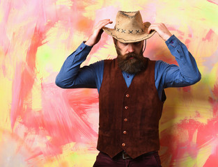Bearded brutal caucasian hipster cowboy