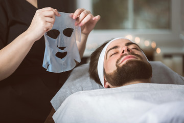 Men's biocellulose mask treatment at spa
