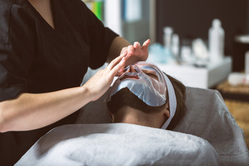 Men's biocellulose mask treatment at spa