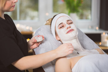 Young woman at enzymatic peeling therapy in spa
