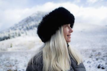 Caucasian woman wearing fur hat in winter