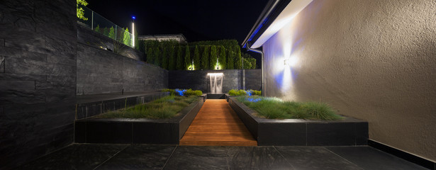zen garden with a fountain at night