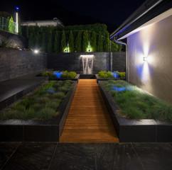 Garden in the yard of luxury villa with fountain