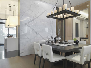Black and white dining table in dining room with marble wall