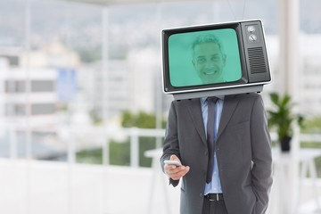 Composite image of businessman and television