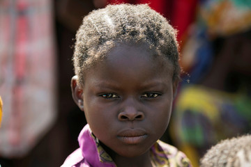 Girl stands in line for food aid distribution in the village of Makunzi Wali, Central African Republic