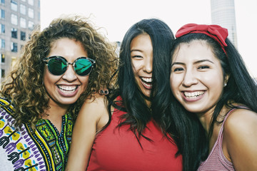 Portrait of women smiling on urban rooftop