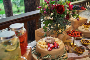 Different kinds of cheese stand served on the brown plate