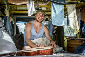 A Portrait Of A Climber Hanging Out Inside His Van