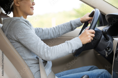 one young woman driver driving car