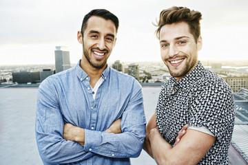 Stylish men posing on urban rooftop