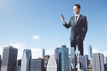 Huge businessman using cellphone