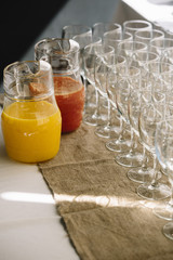 Table with glasses and pitchers with juice